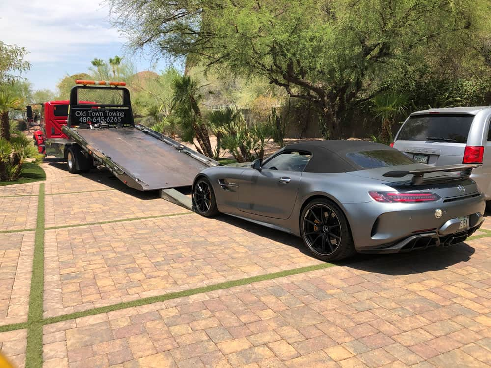 expenisve car getting towed in Scottsdale